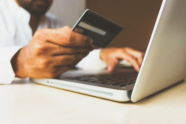man-holding-credit-card-ecommerce